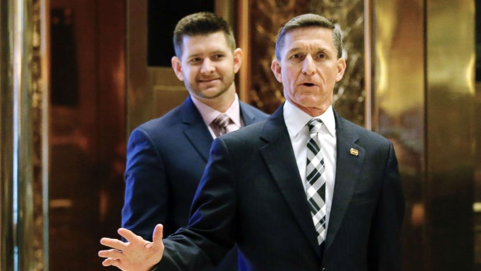 In this file photo dated Nov. 17, 2016, Michael Flynn Jr. is seen behind his father, retired Lt. Gen. Michael Flynn, as they arrive at Trump Tower in New York City.