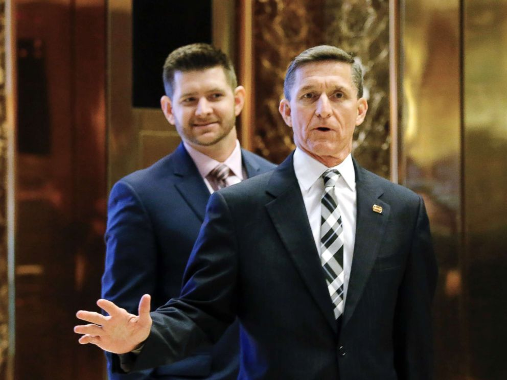 PHOTO: In this file photo dated Nov. 17, 2016, Michael Flynn Jr. is seen behind his father, retired Lt. Gen. Michael Flynn, as they arrive at Trump Tower in New York City.