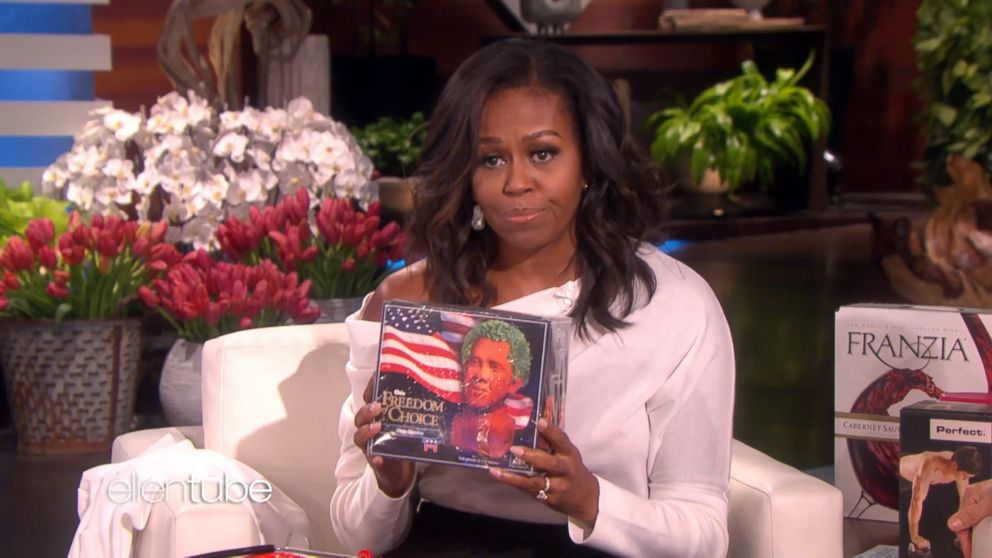"""Michelle Obama presents Ellen with a """"Chia Obama"""" during her guest appearance on """"The Ellen DeGeneres Show,"""" Feb. 1, 2018."""