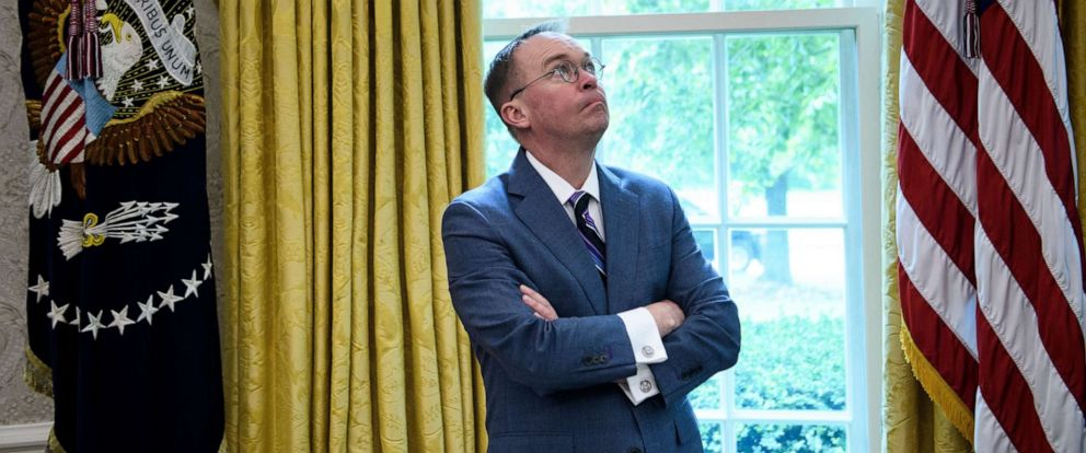 PHOTO: White House acting Chief of Staff Mick Mulvaney listens while President Donald Trump speaks to the press in the Oval Office of the White House on May 13, 2019, in Washington.