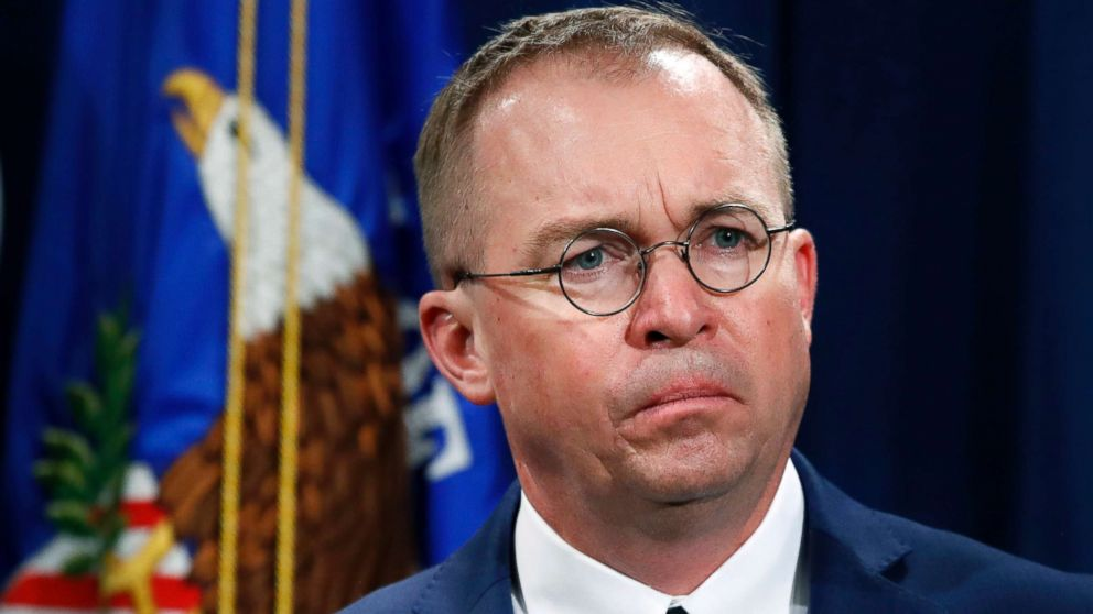 Mick Mulvaney, acting director of the Consumer Financial Protection Bureau (CFPB), and Director of the Office of Management, listens during a news conference at the Department of Justice in Washington, July 11, 2018.