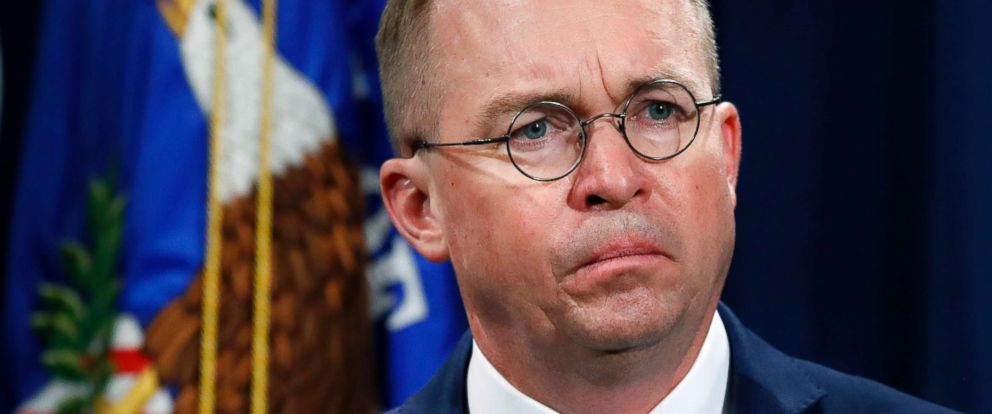 PHOTO: Mick Mulvaney, acting director of the Consumer Financial Protection Bureau (CFPB), and Director of the Office of Management, listens during a news conference at the Department of Justice in Washington, July 11, 2018.