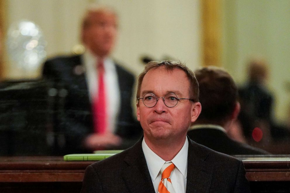 PHOTO: White House Acting Chief of Staff Mick Mulvaney watches as President Donald Trump welcomes the 2018 College Football Playoff National Champion Clemson Tigers in the East Room of the White House in Washington, Jan. 14, 2019.