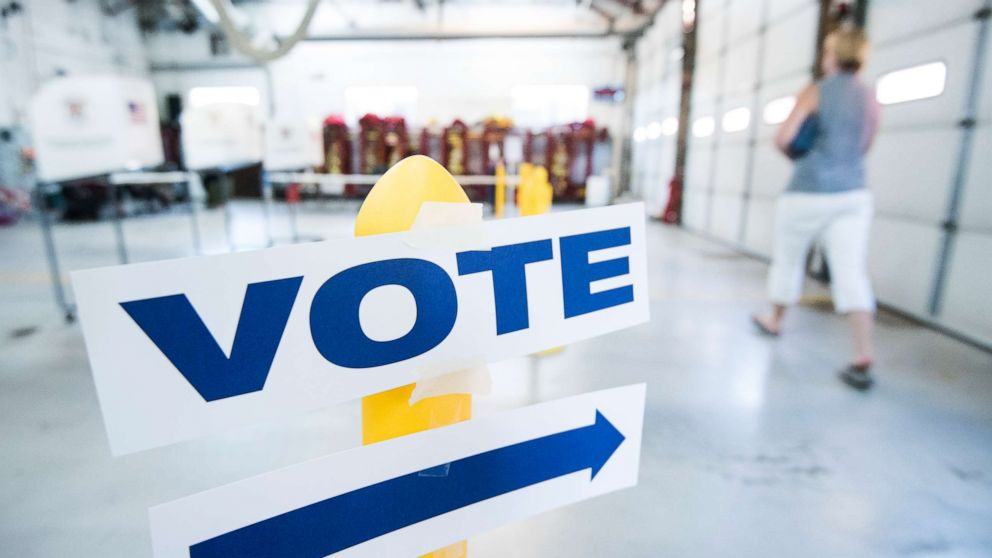 Signs direct voters at the Philomont, Va fire station in Virginia's 10th Congressional district on primary election day, June 12, 2018.
