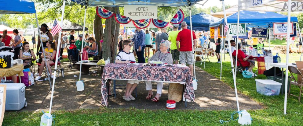 PHOTO: Volunteers at the voter registration booth at the Perry Township Oktoberfest at Hartwick Park in Canton, Ohio, Sept. 15, 2018.