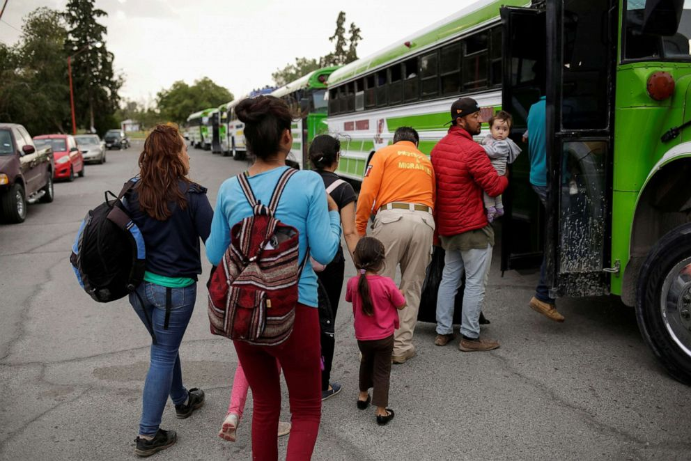 PHOTO: Mexicans fleeing violence board a bus as they are moved to a shelter due a storm forecast in Ciudad Juarez, Mexico, Sept. 30, 2019.
