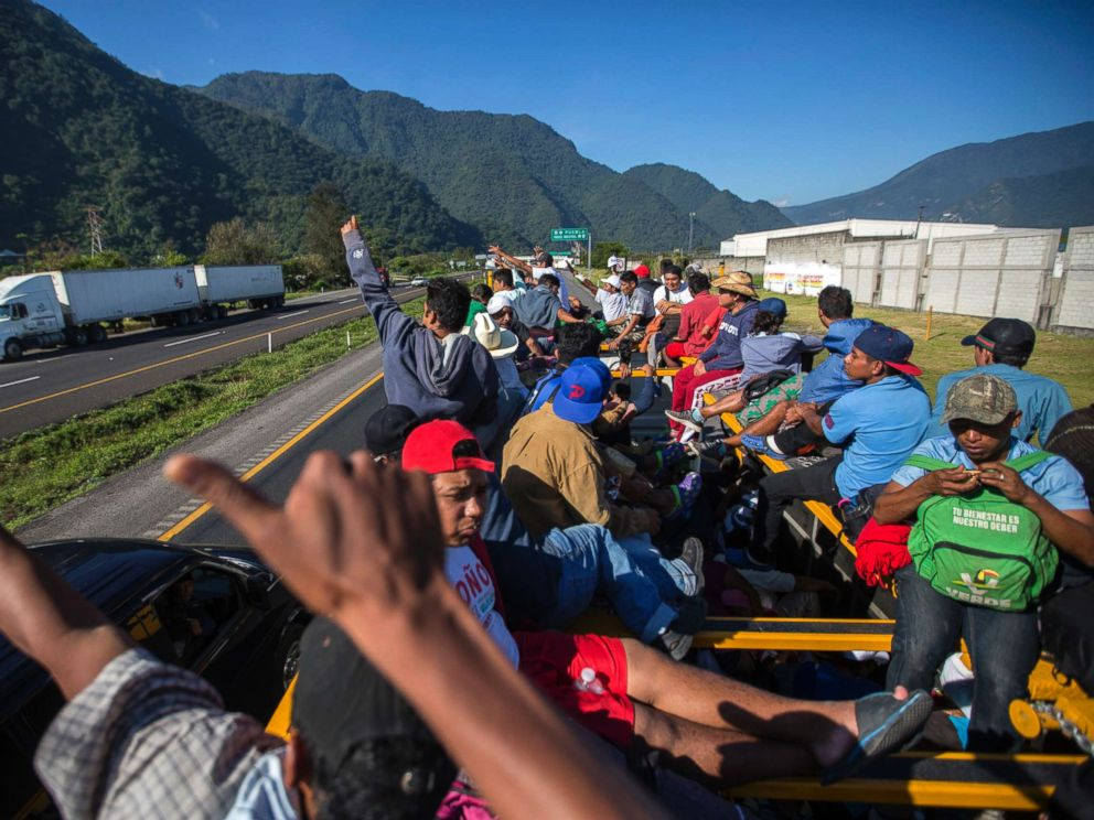 Hundreds of migrants from caravan group reach United States border