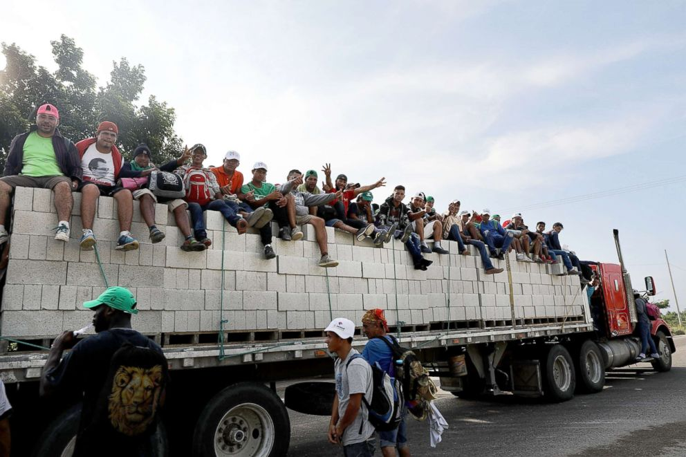 PHOTO: Thousands of Central American migrants in the caravan get a lift to a camp for the evening, Oct. 30, 2018, in Juchitan de Zaragoza, Mexico.