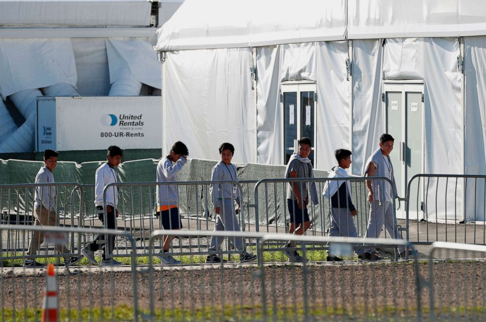 PHOTO: Children line up to enter a tent at the Homestead Temporary Shelter for Unaccompanied Children in Homestead, Fla., Feb. 19, 2019.