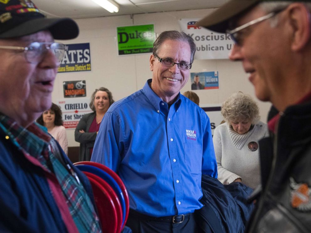 PHOTO: Mike Braun, center, candidate for the Republican nomination for Senate in Indiana, attends the Kosciusko County Republican Fish Fry in Warsaw, Ind., April 4, 2018.
