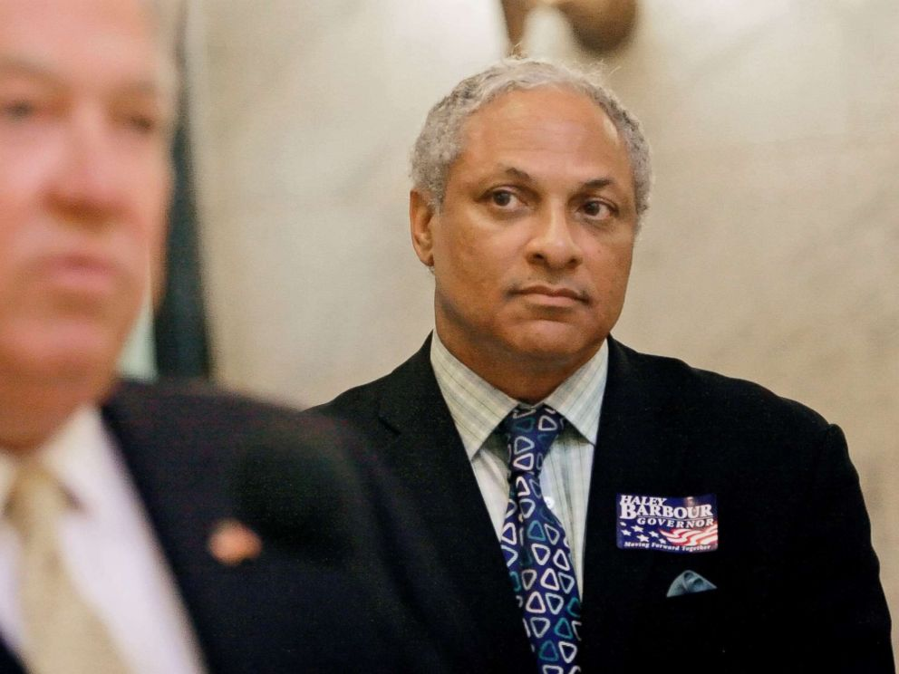 PHOTO: Mike Espy listens to Gov. Haley Barbour during a news conference, Wednesday, Oct. 17, 2007, at the Capitol in Jackson, Miss.