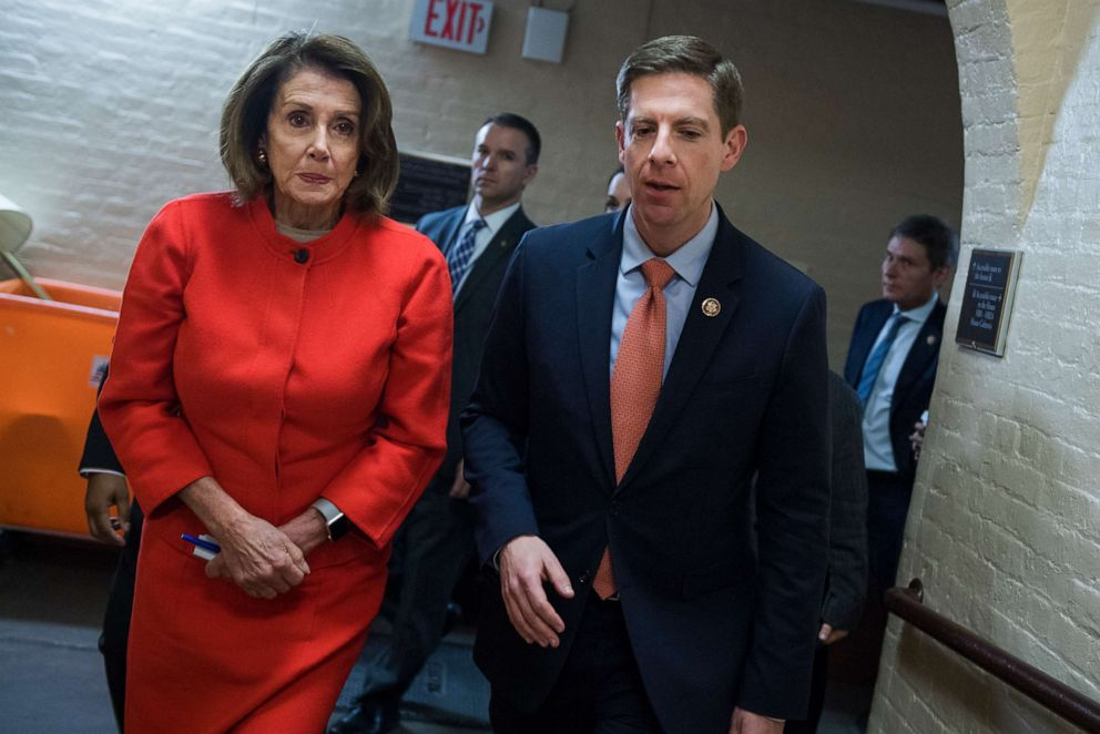 PHOTO: Rep. Mike Levin, right, and Speaker Nancy Pelosi leave a meeting of the House Democratic Caucus in the Capitol on Jan. 30, 2019.