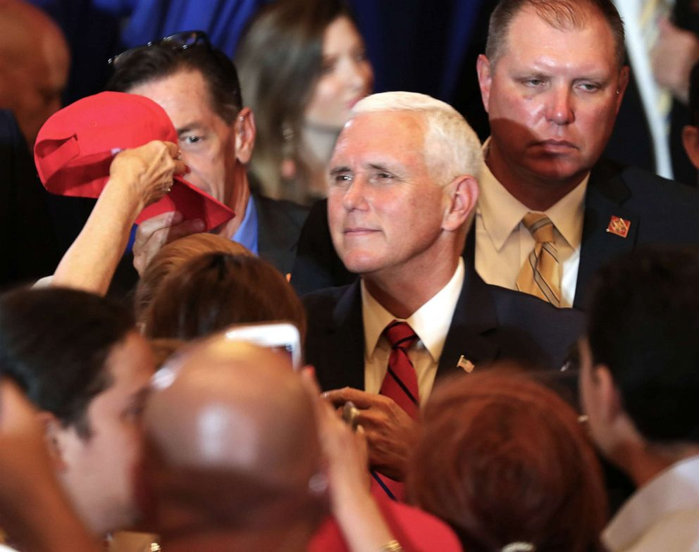 PHOTO: Vice President Mike Pence greets people during the Donald J. Trump for President Latino Coalition Rollout on June 25, 2019 in Miami.