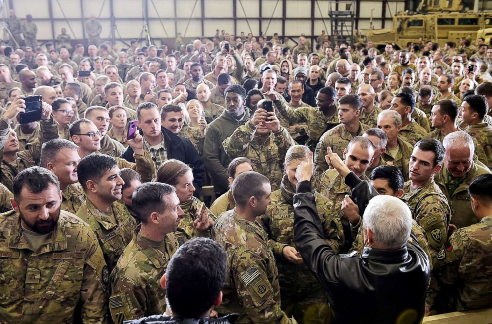 PHOTO: Vice President Mike Pence greets troops in a hangar at Bagram Air Field in Afghanistan, Dec. 21, 2017.