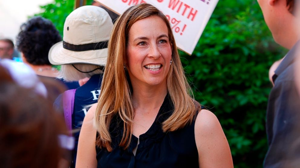 In a Friday, May 19, 2017 photo, Mikie Sherrill joins protesters with NJ 11th for Change in Morristown, N.J.