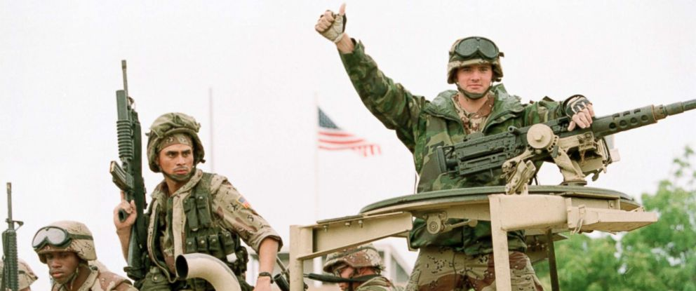 PHOTO: A U.S. Marine gives the thumbs up as a truck load of troops arrive at the reopened U.S. Embassy in Mogadishu, Somalia, Dec. 10, 1992.