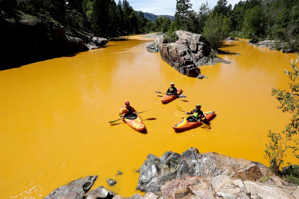 PHOTO: People kayak in the Animas River near Durango, Colo., in water colored from a mine waste spill, Aug. 6, 2015.