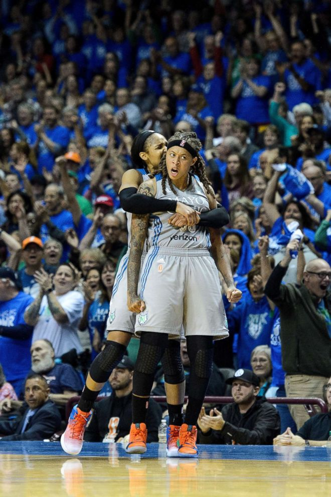 PHOTO: Maya Moore #23 and Seimone Augustus #33 of the Minnesota Lynx celebrate against the Los Angeles Sparks during the fourth quarter of game two of the WNBA Finals, Sept. 26, 2017, in Minneapolis, Minnesota.