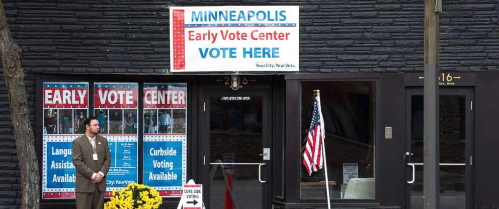 PHOTO: An election support official waits outside the Northeast Early Vote Center to greet voters on Sept. 23, 2016, in Minneapolis.