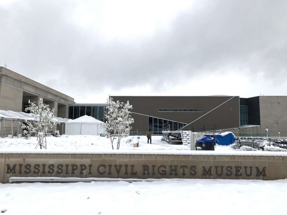 PHOTO: Snow blankets the plaza of the Mississippi Civil Rights Museum in Jackson, Miss., as workers prepare the grounds for opening day ceremonies, Dec. 8, 2017.