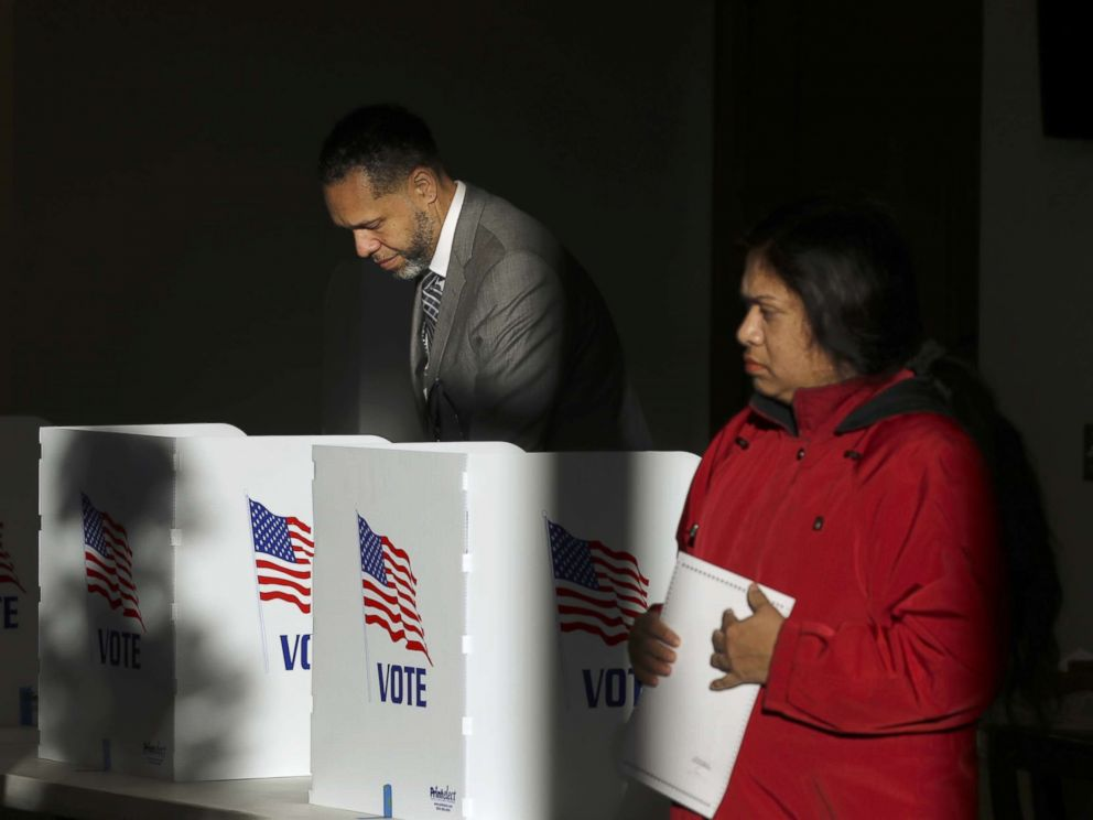 PHOTO: Voters cast their ballots at a polling place at Highland Colony Baptist Church, Nov. 27, 2018, in Ridgeland, Mississippi.