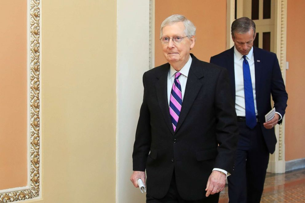 PHOTO: Senate Majority Leader Mitch McConnell walks to speak to reporters on Capitol Hill in Washington, Feb. 26, 2019.