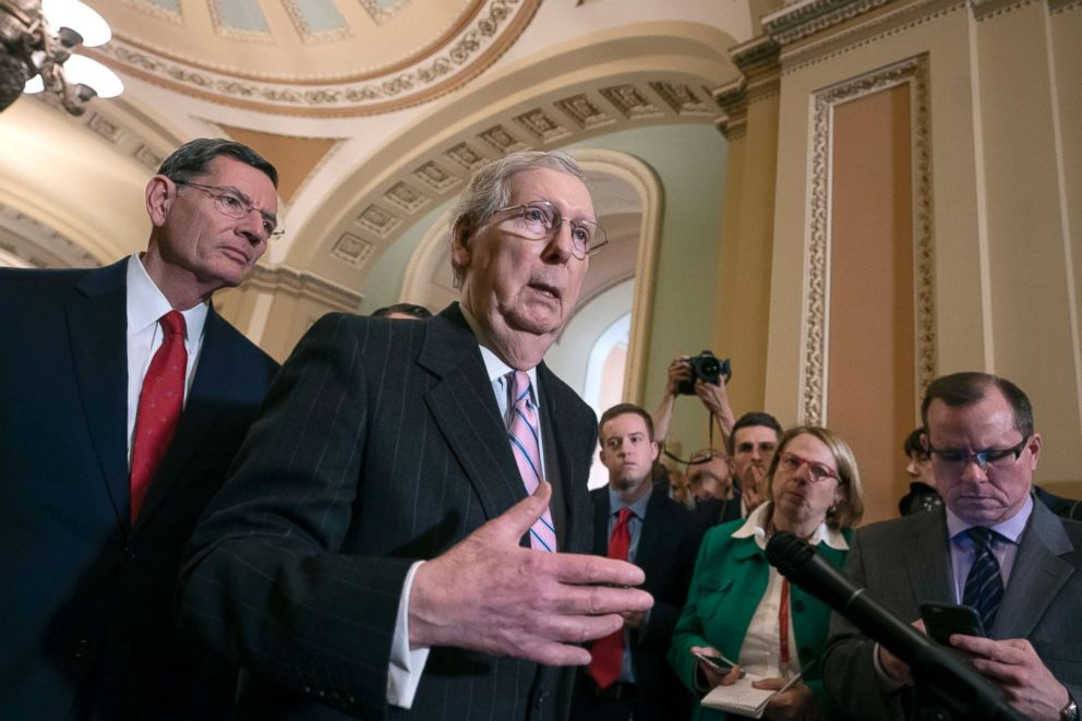 PHOTO: Senate Majority Leader Mitch McConnell, joined at left by Sen. John Barrasso, speaks to reporters following a closed-door GOP policy meeting at the Capitol in Washington, March 12, 2019.
