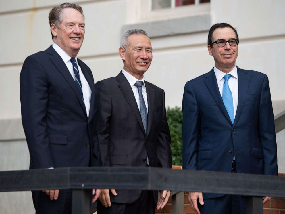 PHOTO: Treasury Secretary Steven Mnuchin (R) and Trade Representative Robert Lighthizer (L) greet Chinese Vice Premier Liu He as he arrives for trade talks at the Office of the U.S. Trade Representative in Washington, D.C., Oct. 10, 2019.