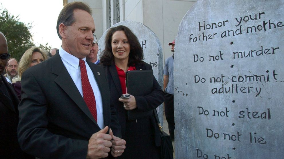 Roy Moore looking at a Ten Commandments display used in a rally as he arrives at the Judicial Building in Montgomery, Ala., Nov. 12, 2003.