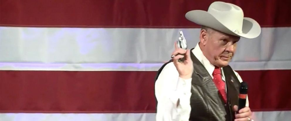 PHOTO:Alabama Senate candidate Roy Moore draws a handgun from his pocket at a campaign rally in Fairhope, Ala., Spet. 25, 2017.