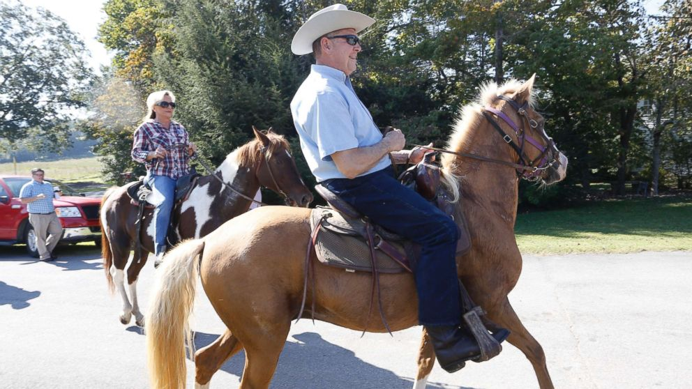 Alabama Republican U.S. Senate candidate Roy Moore on Sassy and wife Kayla on Sundance ride their horses to the Gallant Fire Hall to vote in the GOP runoff election Sept. 26, 2017 in Gallant, Ala.