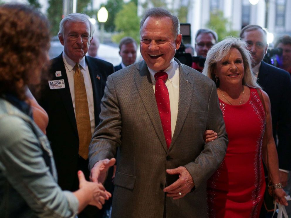 PHOTO: Republican candidate Roy Moore and his wife Kayla are greeted at the door as they arrive at the RSA Activity Center in Montgomery, Alabama, September 26, 2017, during the runoff election for the Republican nomination for Alabamas U.S. Senate seat.