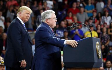 PHOTO: President Donald Trump, left, listens as Republican Senate candidate Patrick Morrisey, currently West Virginia Attorney General, speaks during a rally, Aug. 21, 2018, in Charleston, W.Va.