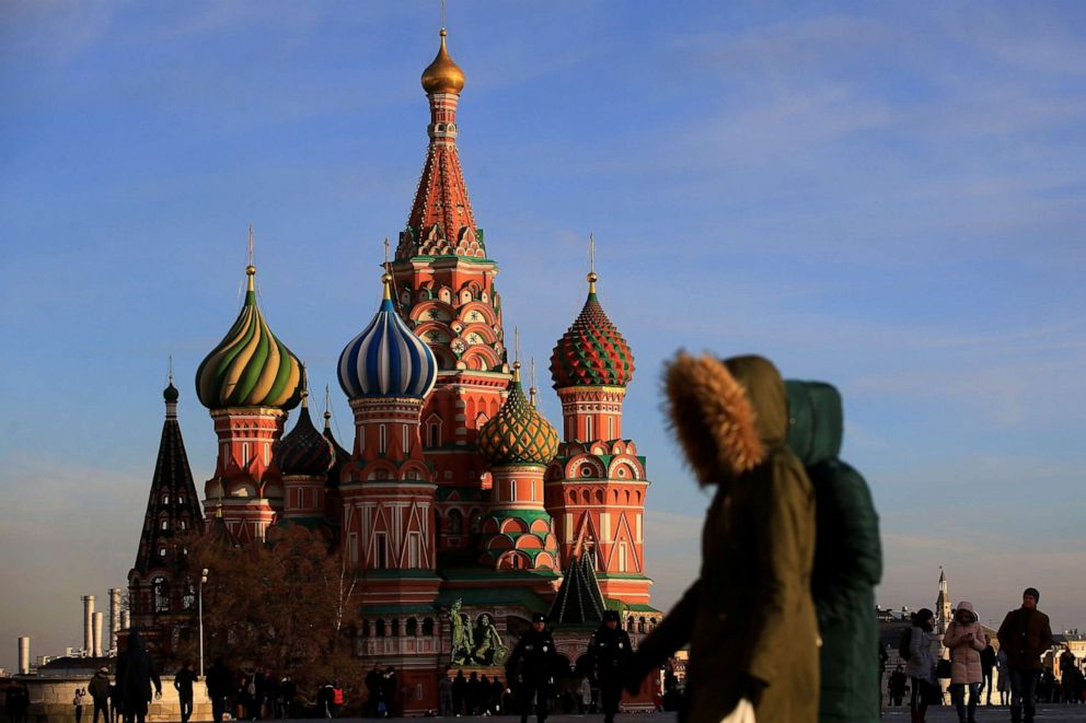 PHOTO: People walk at the Red Square as the Saint Basils Cathedral is seen in the background in Moscow, March 28, 2019.