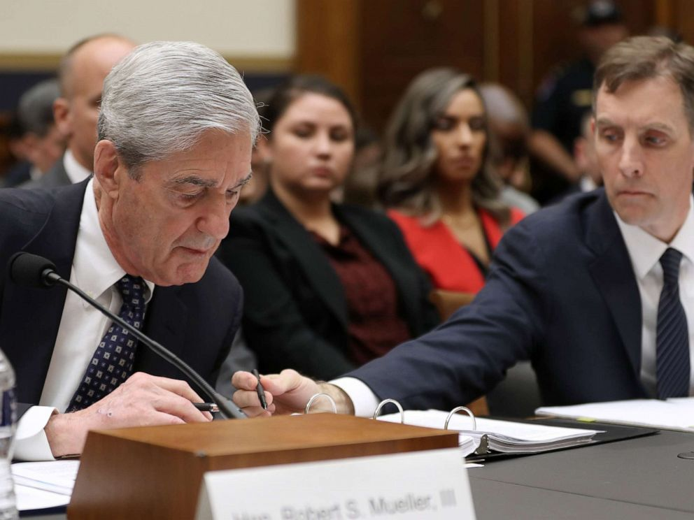 PHOTO: Former Special Counsel Robert Mueller and former Deputy Special Counsel Aaron Zebley, right, go over notes as Mueller testifies before the House Judiciary Committee about his report, July 24, 2019 in Washington, D.C.