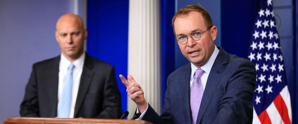 PHOTO: Office of Management and Budget Director Mick Mulvaney, right, with White House Director of Legislative Affairs and Assistant Marc Short, talks to reporters at the White House, March 22, 2018.