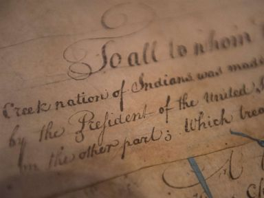 PHOTO: A detail of the 1790 Treaty of the Muscogee Creek Nations and the United States sits on display at the Smithsonians National Museum of the American Indian on March 16, 2015 in Washington.