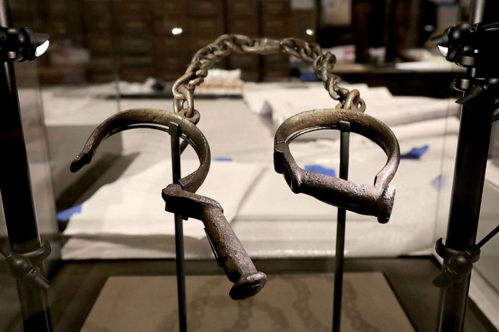 PHOTO: A pair of slave shackles are on display in the Slavery and Freedom Gallery in the Smithsonians National Museum of African American History and Culture during the press preview on the National Mall Sept. 14, 2016, in Washington, D.C.