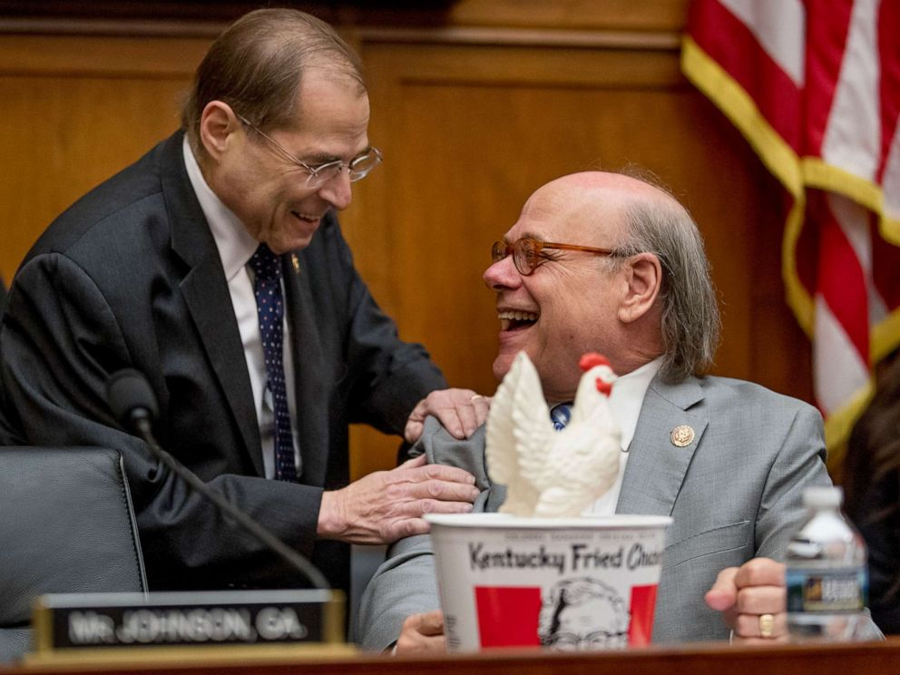 PHOTO: Judiciary Committee Chairman Jerrold Nadler, left, laughs with Rep. Steve Cohen, right, after Cohen arrived with a bucked of fried chicken as Attorney General William Barr skipped the House Judiciary Committee hearing on Capitol Hill, May 2, 2019.