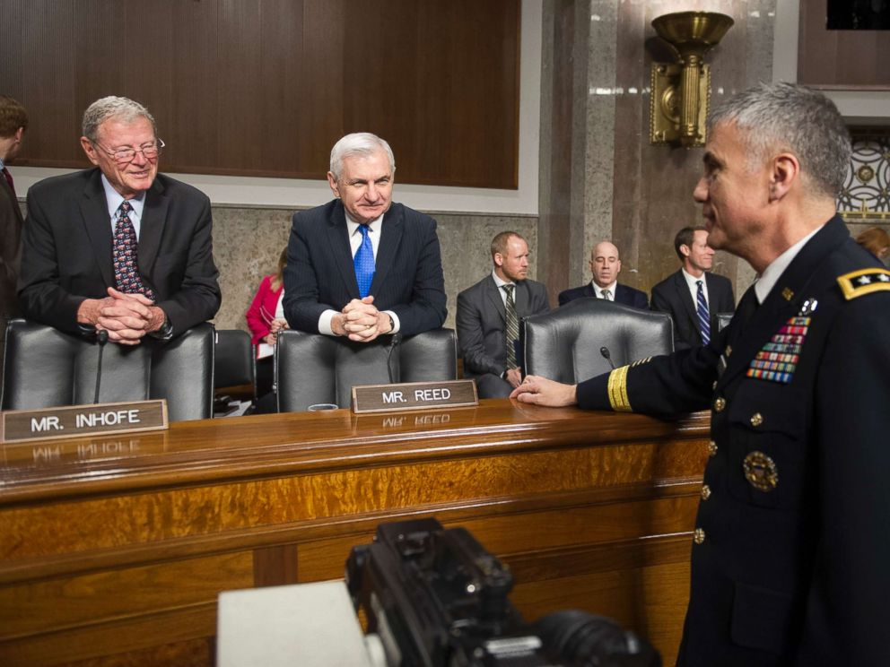 PHOTO: Army Lieutenant General Paul Nakasone, right, talks with Senate Armed Services Committee Chairman James Inhofe, R-Okla., left, and ranking member Sen. Jack Reed, D-R.I., during a hearing on Capitol Hill in Washington, March 1, 2018.