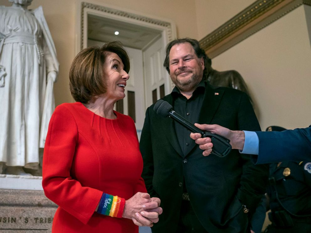 PHOTO: Speaker of the House Nancy Pelosi, joined by internet entrepreneur Marc Benioff, right, arrives for the vote on The Equality Act of 2019 at the Capitol in Washington, May 17, 2019.