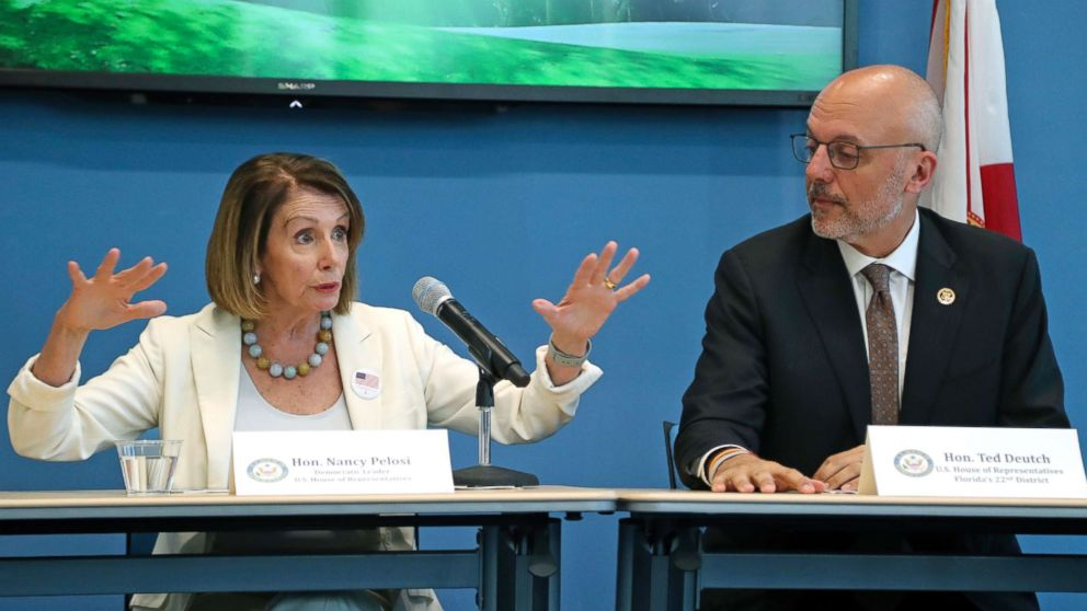 Rep. Ted Deutch looks on as House Minority Leader Nancy Pelosi speaks during a roundtable on gun violence at Coral Springs City Hall, Oct. 17, 2018, in Coral Springs, Fla.