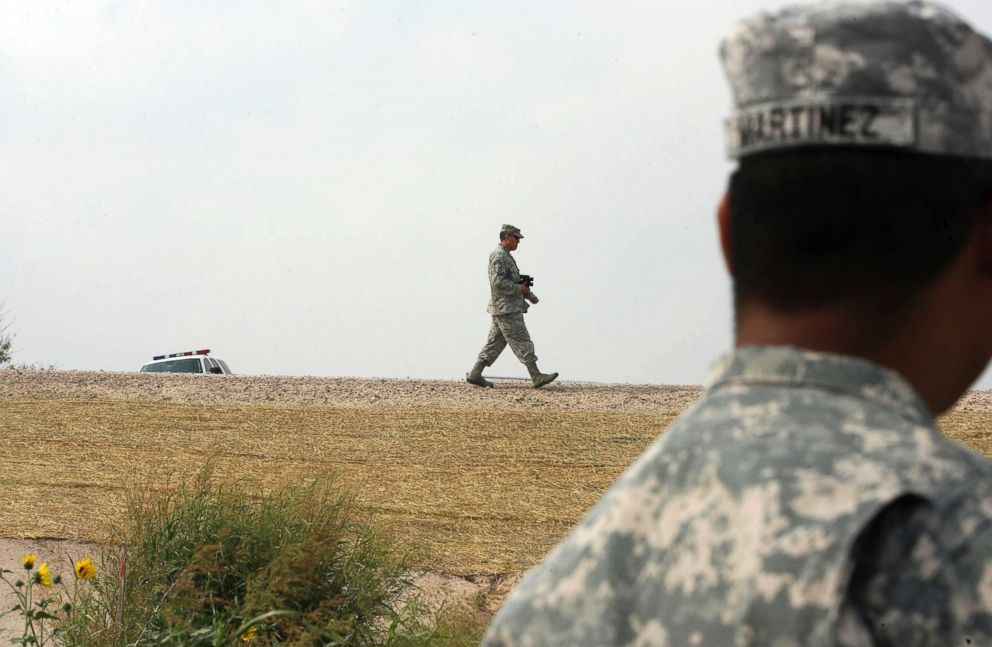 2011 file photo OF U.S. National Guard troops patrolling near the Hidalgo International Bridge in Hidalgo, Texas.