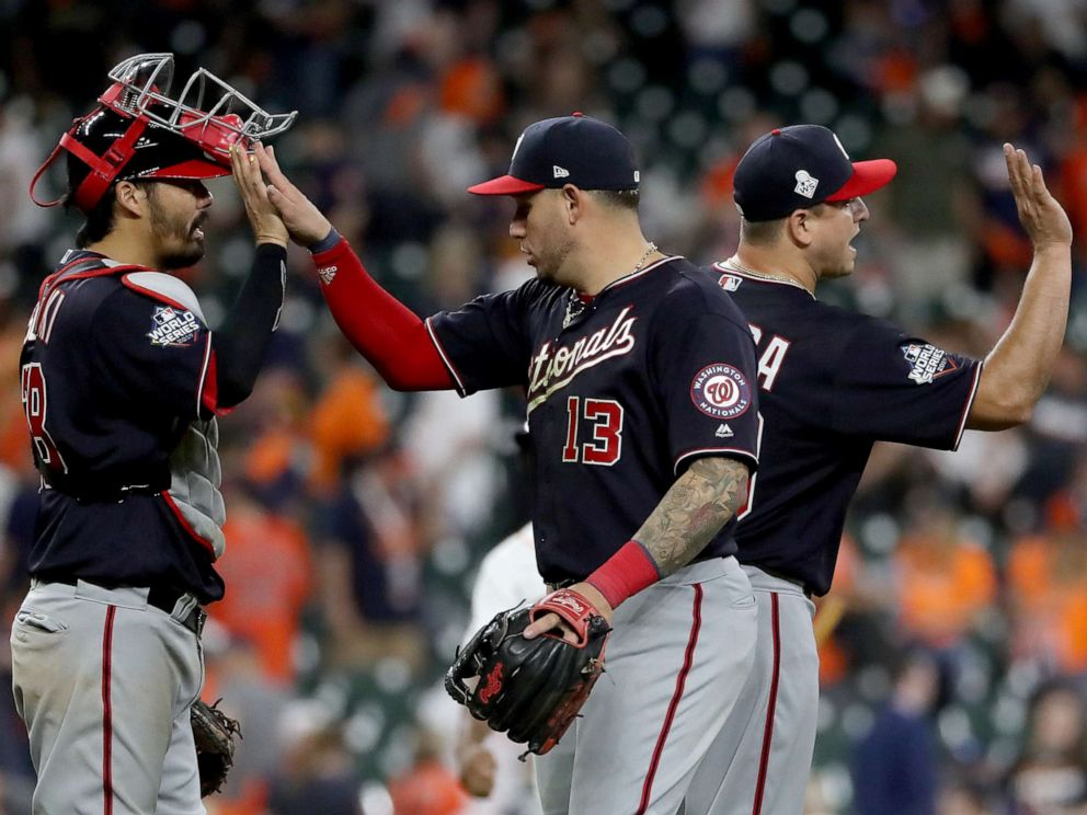 PHOTO: Asdrubal Cabrera #13 and Kurt Suzuki #28 of the Washington Nationals celebrate their teams 12-3 win over the Houston Astros in Game Two of the 2019 World Series at Minute Maid Park on Oct. 23, 2019 in Houston, Texas.