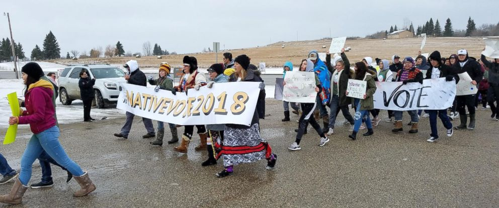 PHOTO: A group of activists march to a polling place on the Turtle Mountain Indian Reservation in Belcourt, N.D., Nov. 6, 2018.