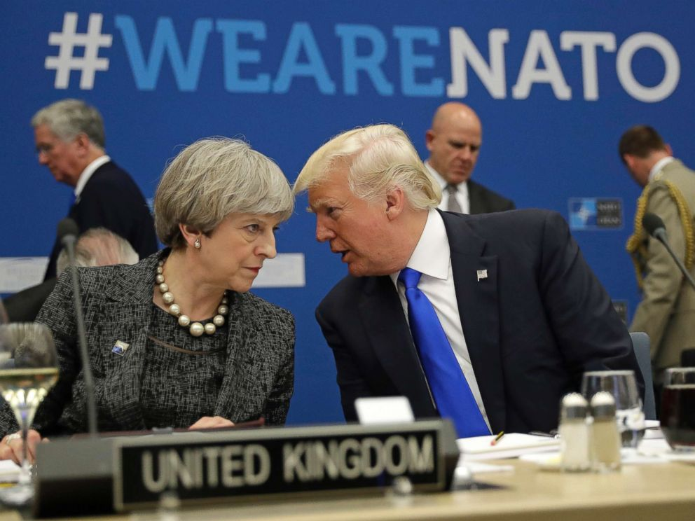 PHOTO: British Prime Minister Theresa May, left, speaks to U.S. President Donald Trump during a working dinner meeting at the NATO headquarters during a NATO summit of heads of state and government in Brussels, May 25, 2017.