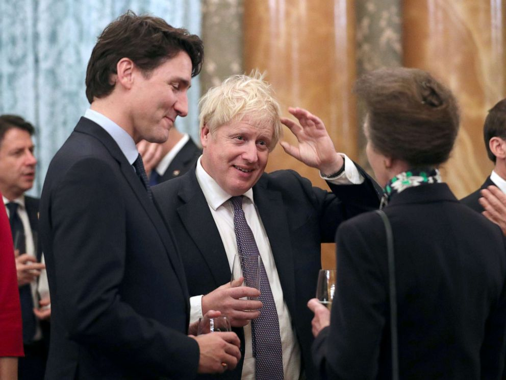 FILE PHOTO: Britains Princess Royal Anne talks to Prime Minister Boris Johnson and Canadian Prime Minister Justin Trudeau during reception at Buckingham Palace to mark 70 years of the NATO Alliance.