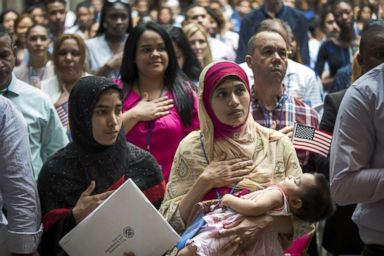 PHOTO: Mosammat Rasheda Akter, originally from Bangladesh, recites the Pledge of Allegiance after officially becoming a U.S. citizen during a naturalization ceremony at the New York Public Library, July 3, 2018.