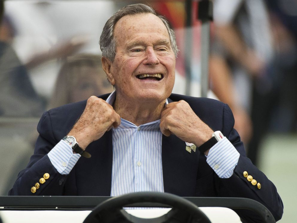 PHOTO: Former President George H.W. Bush sits on the sidelines before a game between the Houston Texans and Oakland Raiders, in Houston, in this Nov. 17, 2013 photo.