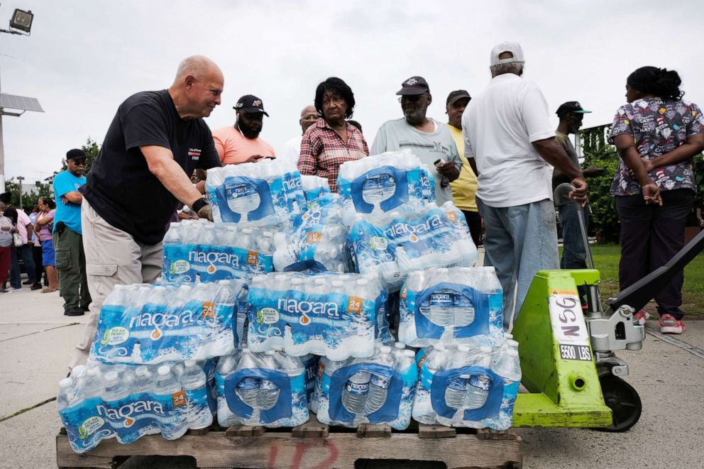 PHOTO: A pallet of bottled water is delivered to a recreation center on August 13, 2019 in Newark, New Jersey.